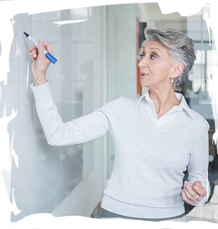 Image of woman at whiteboard